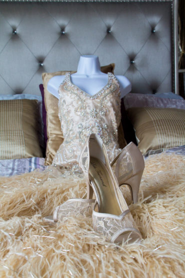 Quinceanera shoes in front of a quinceanera dress