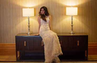 Quinceanera leaning on a desk greater than gatsby styled shoot