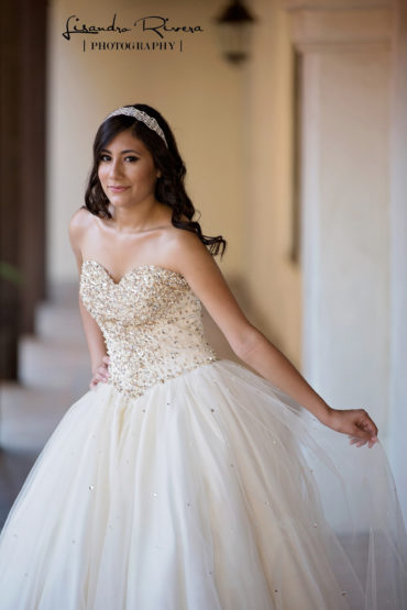 Quinceanera pose in a spanish style building