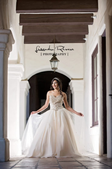 Elegant Quinceanera Pose in Spanish style arches